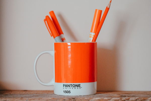 Orange Cup holding brand guidelines for content strategy