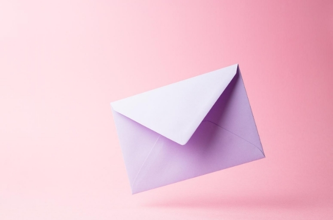 white envelope on a pink background