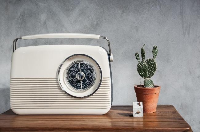 vintage white radio on a wood table